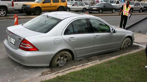 Dallas Mercedes Driver Parks In Wet Concrete