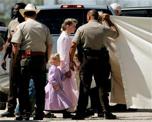Polygamist Sect Raided On Charges Of Abuse Of Girls