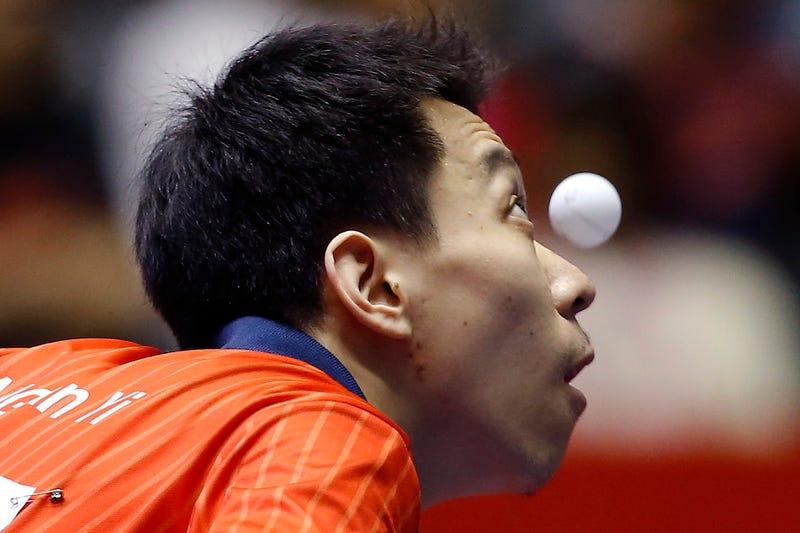 Ping Pong Players Staring At Balls