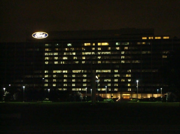 Ford Wishes GM Happy 100th Birthday On Side Of World Headquarters, Saves Money On Card, Cake