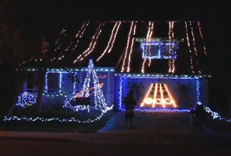Guitar Hero Played On Side of House in Christmas Lights Invents New Class of Neighborhood Competition