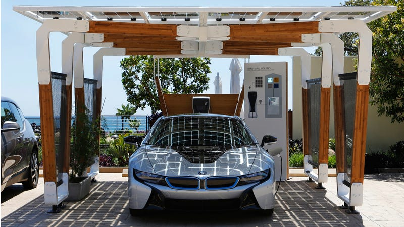 BMW's Solar-Powered Carport Is A Carbon Fiber And Bamboo Ecosculpture
