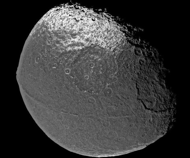 The solar system's weirdest moon once had a moon all its own