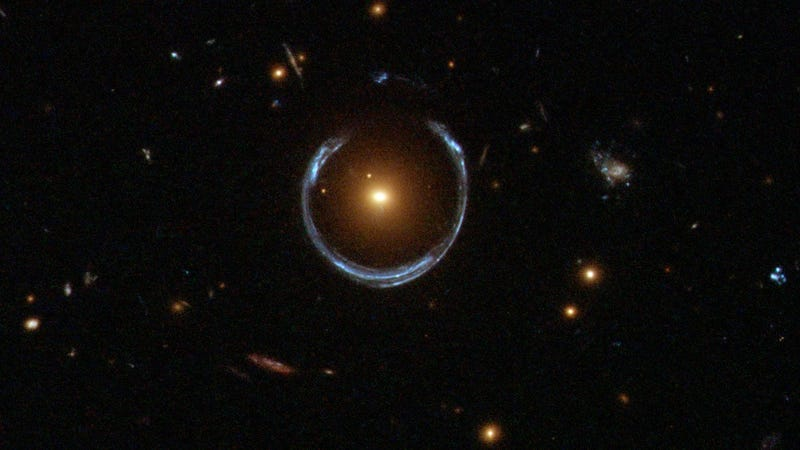 Gravitational lensing twists distant galaxy into an Einstein Ring