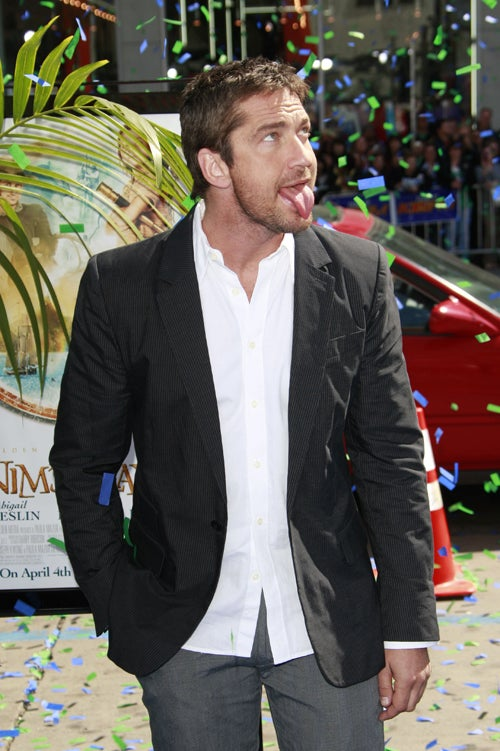 Gerard Butler Catches Faux Raindrops On His Tongue