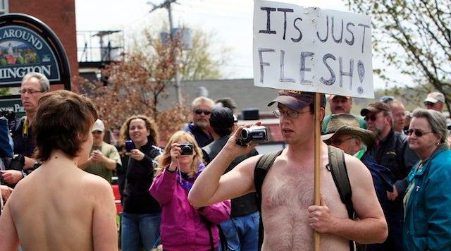 Pro And Anti-Topless Protesters Face Off