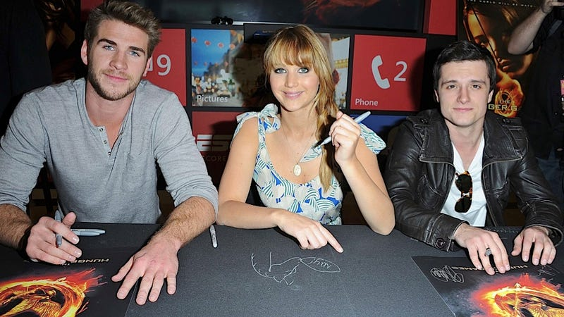 The Hunger Games Stars Risk Carpal Tunnel to Sign Your Posters