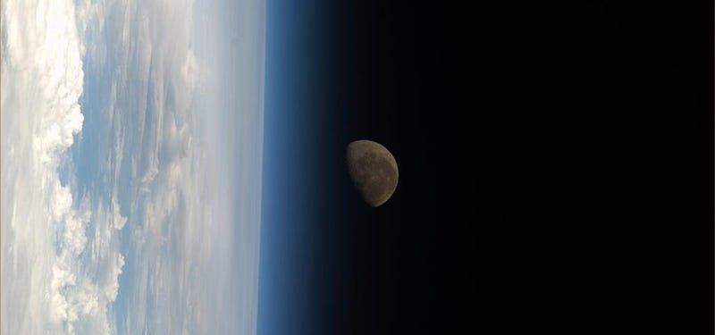 The Moon sets behind Earth as a storm of light roars in Australia