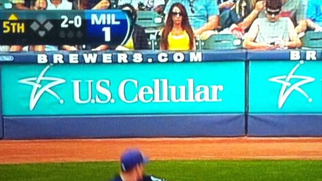 I-Team: A Reader Wants To Know More About The Buxom Lass Behind Home Plate At Miller Park (UPDATE)