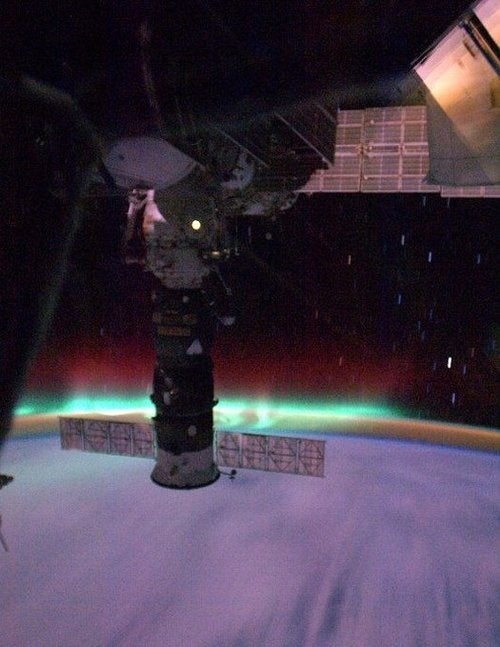 International Space Station In Aurora Collision Course