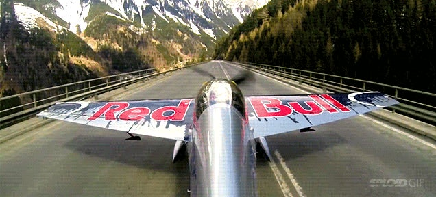 Pilot takes off from car road in the Alps to do some crazy acrobatics