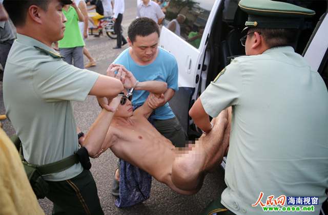 Naked Man Meditates in Busy Chinese Street