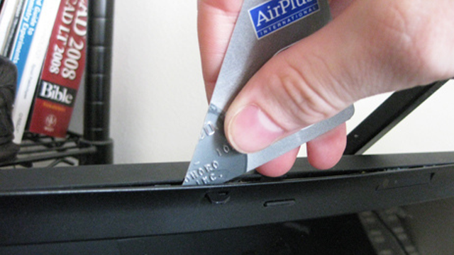 Use A Cut Credit Card To Open Plastic Cases Without Messing Them Up