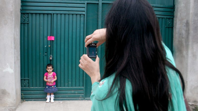 Lady Takes Baby Pictures Beside Osama Bin Laden's Hideaway
