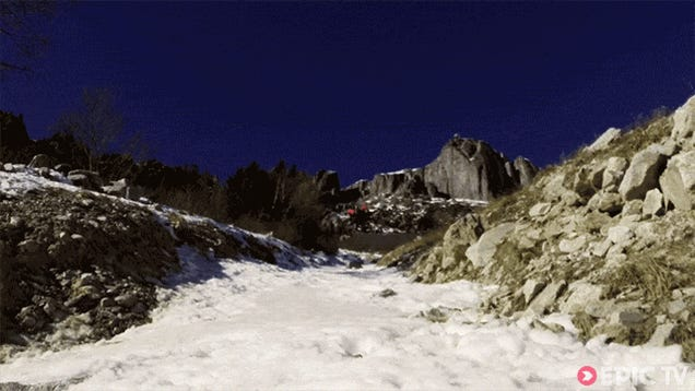 Flying man in wingsuit flies deathly close to the ground like Superman