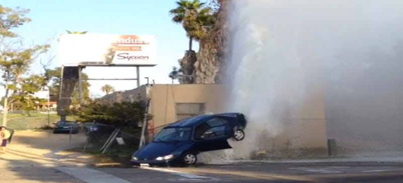 Watch A Broken Hydrant Lift Half A Car Straight Off The Ground