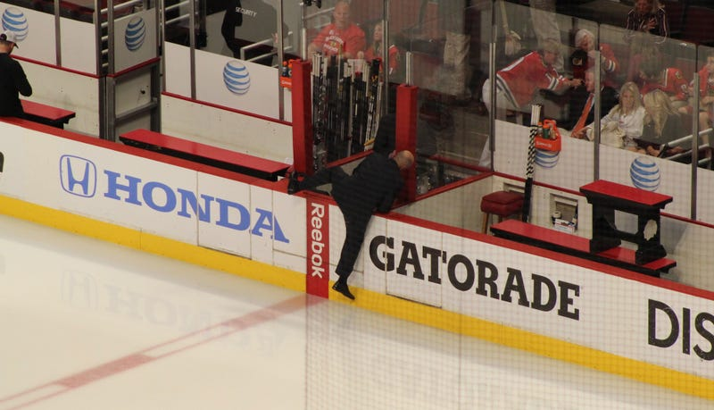 I Can't Stop Looking At These Pics Of Pierre McGuire Scaling The Boards