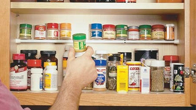 Use a Tension Rod To Create a Second Shelf in Your Kitchen Cabinet for Spices