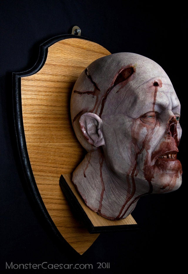 Mounted zombie head shows that you are a decorator of undead distinction