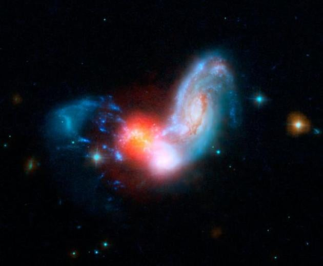 Colliding galaxies cause incredibly bright starbust inside cloak of dust