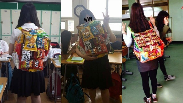 Korean Schoolgirls Wearing Backpacks Made of Junk Food