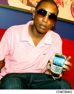Music Mogul Pharrell Williams and His 18-Karat-gold Blackberry