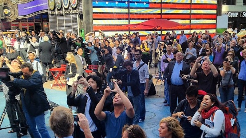 Poor People Photograph Rich People on Times Square Jumbotron