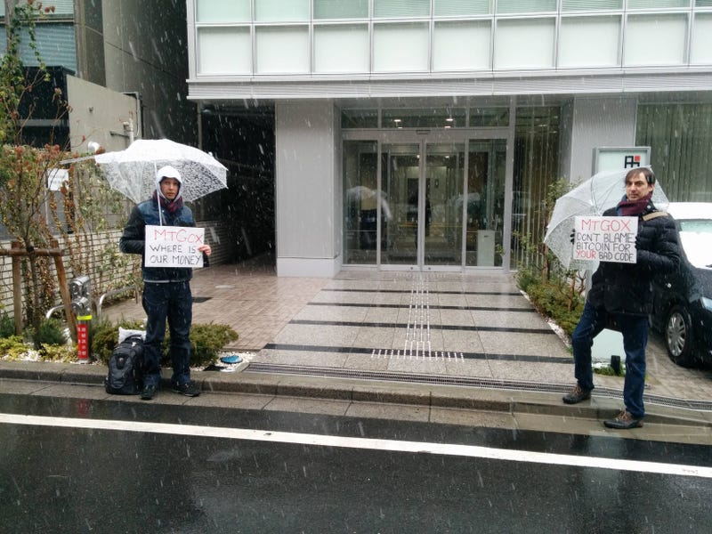 Sad People Are Standing on the Sidewalk in Tokyo to Protest Bitcoin