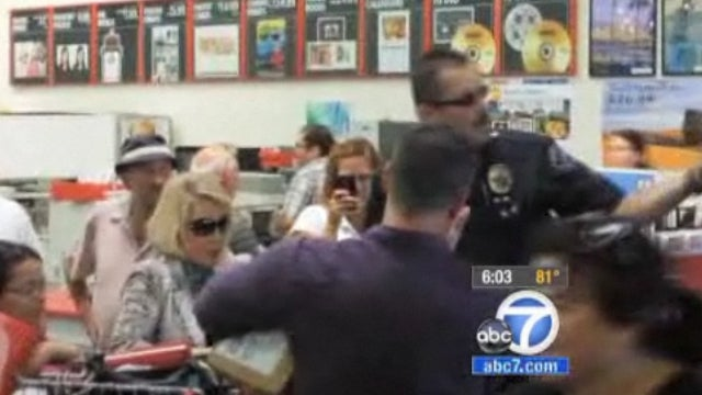 Joan Rivers Handcuffs Self to Shopping Cart in Costco Store to Protest Chain's Ban of Her Latest Book