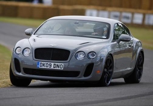 Derek Bell Hustles Bentley Continental Supersports Up Goodwood Hill Climb