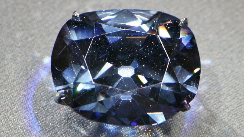 Why does the Hope Diamond glow red in UV light?