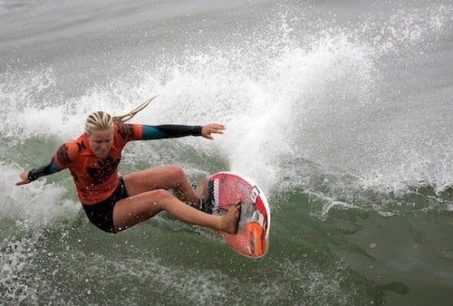 Goofy-Foot Surfer Carves A Wave
