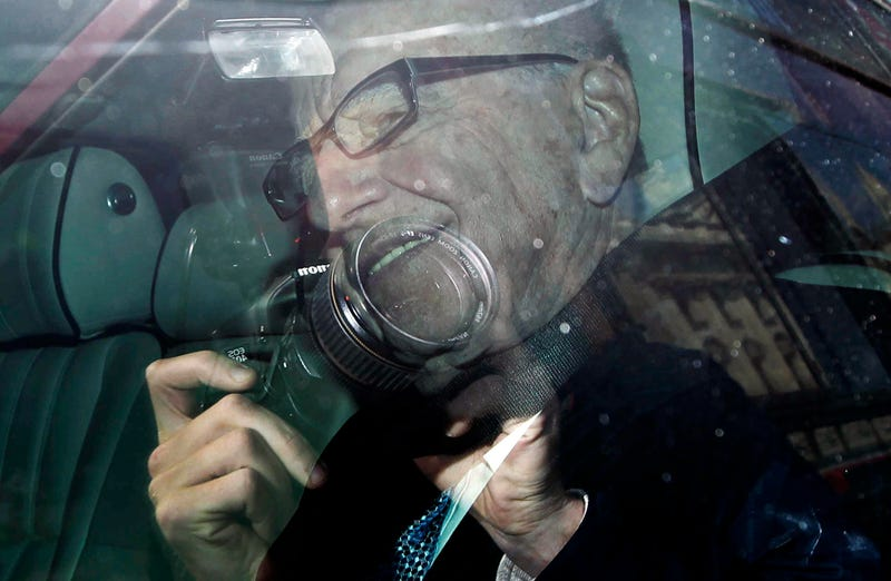 Rupert Murdoch's SUV Gets Chased Off by Photographers