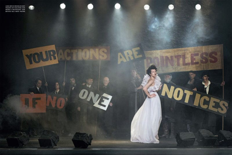 Incredibly Lovely: Milla Jovovich marches with Jenny Holtzer slogans in a dystopian future