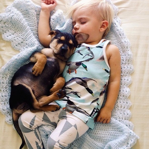 Mother Snaps Impossibly Adorable Photos of Son Napping with Puppy