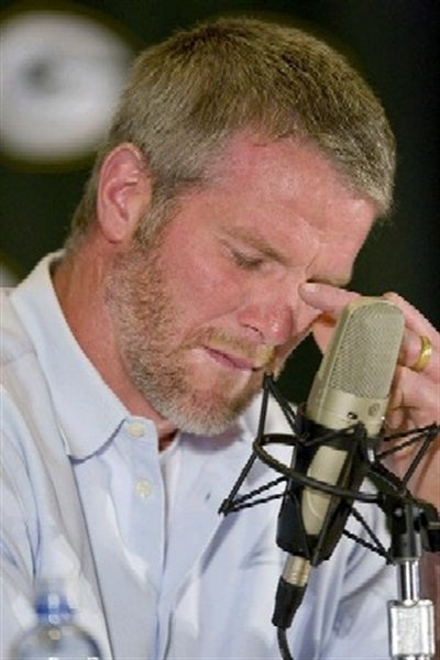 Brett Favre Has His Hands Full With Tears