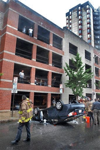 Hyundai Driver Backs Off Fourth Floor Of Parking Garage