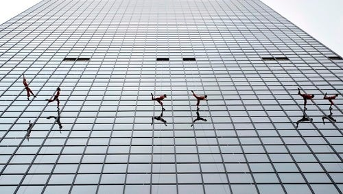 What Are These People Doing Dancing on the Side of a Building?