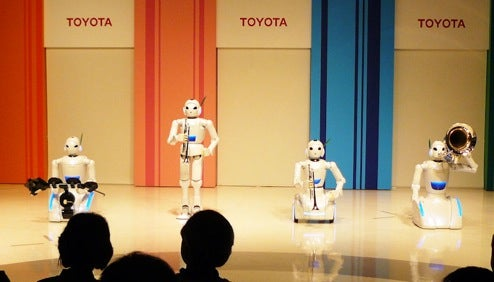 Toyota One-Ups ASIMO's Conducting Performance with Robot Orchestra
