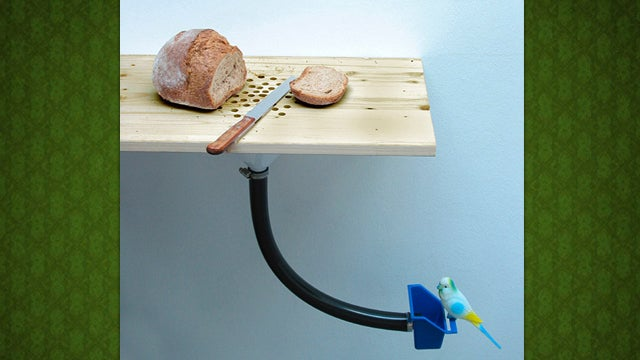 DIY Cutting Board Bird Feeder Disposes of Your Old Crumbs