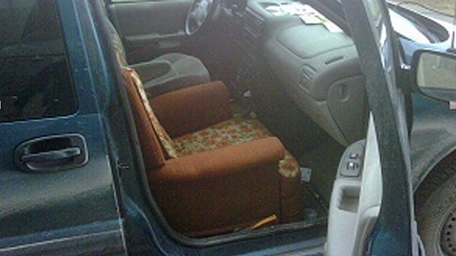 In this van, calling shotgun means you get dad's recliner