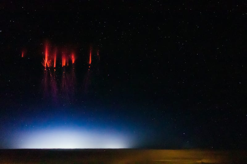 "Ethereal photos capture rare ""red lightning"" phenomenon"