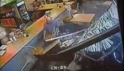 CCTV Awesomeness: How to React When a Car Crashes Into You During Lunch