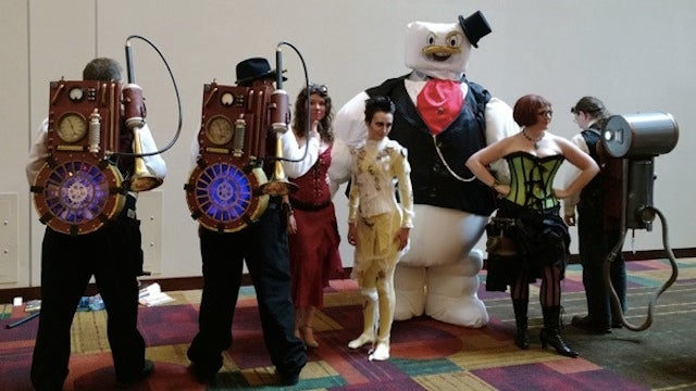 Steampunk Ghostbusters Cosplayers with a Dapper Marshmallow Man