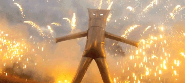 Mad genius invents steel safe suit to stand inside a fireworks display
