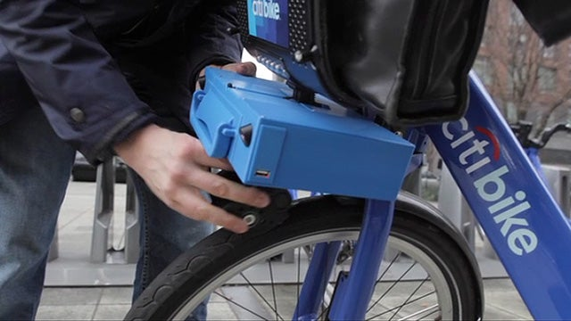 A Tiny Briefcase That Turns Citibikes Into Electric Scooters
