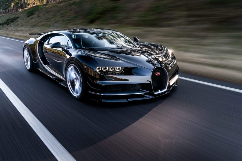 'Bugatti Chiron: This Is A Lot More Of It ' from the web at 'http://i.kinja-img.com/gawker-media/image/upload/s--7q-kWifj--/c_scale,fl_progressive,q_80,w_800/feeo6xvblin2pwufxtdd.jpg'