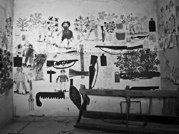 Photos of an abandoned asylum shot in black and white, complete with creepy mural