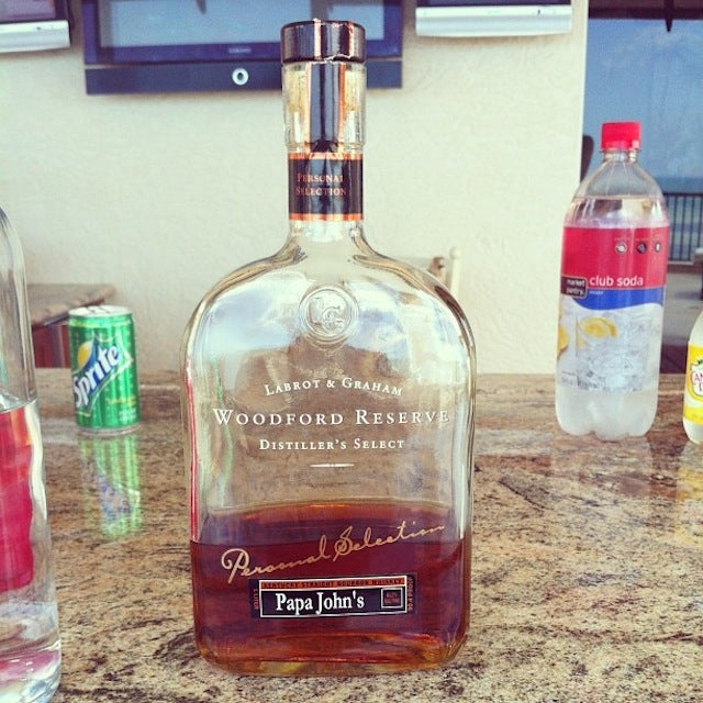 Here's A Special Bottle Of Woodford Reserve With Papa John's Name On It