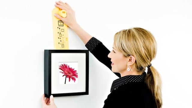 The Hang and Level Makes Positioning Photos and Art Together on the Wall Quick and Easy